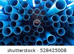 Blue PVC tubes in storage, Plastic tubes, Background of PVC - stock photo