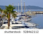 Small photo of Port of Cavalaire-sur-Mer with palm tree in the foreground, commune in the Var department in the Provence-Alpes-Côte d'Azur region in southeastern France.