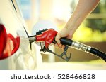 hand refilling the car with... | Shutterstock . vector #528466828