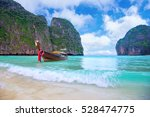 long boat and blue water at... | Shutterstock . vector #528474775