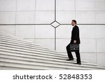 man with a suitcase lifting... | Shutterstock . vector #52848353