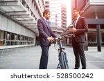 businessmen talking while... | Shutterstock . vector #528500242