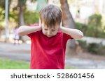 little caucasian boy closing... | Shutterstock . vector #528601456