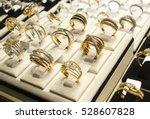 golden rings with diamonds and... | Shutterstock . vector #528607828