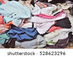 pile of messy clothes in closet.... | Shutterstock . vector #528623296