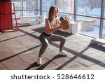 young woman doing squats with... | Shutterstock . vector #528646612