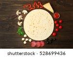 pizza ingredients on wooden... | Shutterstock . vector #528699436