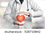 cardiologist with heart in...   Shutterstock . vector #528710842