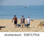 Three Fishermen Carrying...