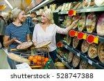 adult girl helping senior... | Shutterstock . vector #528747388