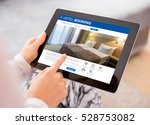 person booking hotel room on... | Shutterstock . vector #528753082