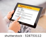 person tracking shipment on... | Shutterstock . vector #528753112