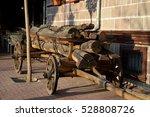 A Cart Of Firewood Near The...