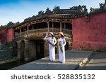 two vietnamese woman stand... | Shutterstock . vector #528835132