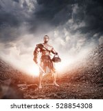 ancient Rome gladiator Hoplomachus warrior with sword and helmet posing on epic background dramatic landscape