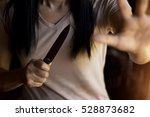 woman holding a knife in hand... | Shutterstock . vector #528873682