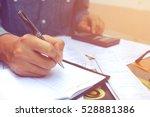 businessman doing finances with ... | Shutterstock . vector #528881386