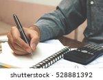 finance concept. man writing... | Shutterstock . vector #528881392