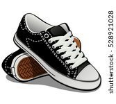 a pair of sneakers with white... | Shutterstock .eps vector #528921028