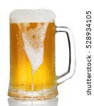 Cold Mug Of Beer With Foam...
