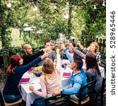 group of friends at restaurant... | Shutterstock . vector #528965446