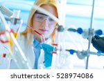 a young chemist holding test... | Shutterstock . vector #528974086