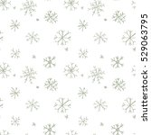 hand drawn snowflakes on white... | Shutterstock .eps vector #529063795