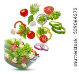 Small photo of Falling vegetables in a salad bowl