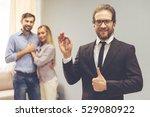 handsome realtor in suit is... | Shutterstock . vector #529080922