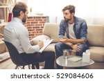 handsome young man is sitting... | Shutterstock . vector #529084606