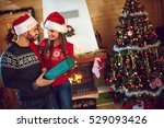 man receiving christmas gift... | Shutterstock . vector #529093426
