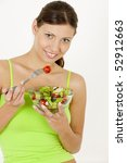 portrait of woman eating salad | Shutterstock . vector #52912663