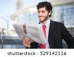 smiling businessman reading a...   Shutterstock . vector #529142116