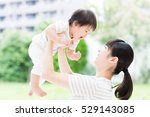 Portrait Of Asian Mother And...