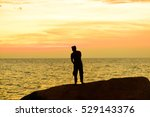 silhouettes of fisherman on the ... | Shutterstock . vector #529143376
