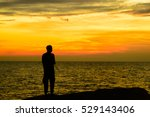silhouettes of fisherman on the ... | Shutterstock . vector #529143406