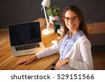 young female working sitting at ... | Shutterstock . vector #529151566