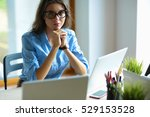 young woman sitting at office... | Shutterstock . vector #529153528