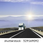 truck on the mountain road at... | Shutterstock . vector #529169092