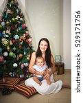 baby with mum sitting near...   Shutterstock . vector #529171756