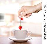 strawberry tea in a plain white ... | Shutterstock . vector #529179142