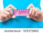 woman hand holding... | Shutterstock . vector #529275802