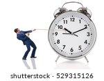 businessman pulling clock in...