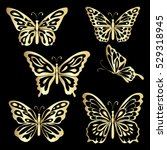 gold lace butterfly on black... | Shutterstock .eps vector #529318945
