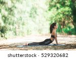 young asian woman doing yoga in