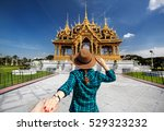 woman in hat and green checked... | Shutterstock . vector #529323232