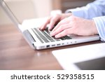 male hands typing on laptop... | Shutterstock . vector #529358515