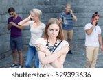 sad girl standing among people...   Shutterstock . vector #529393636