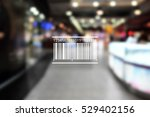 Small photo of Barcode on blurred shopping mall background. Wholesale and retail concept.