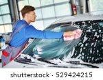 man worker washing windshield... | Shutterstock . vector #529424215